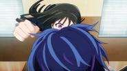 Kisara about to punch Rentaro