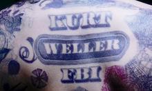 Wellertat.png