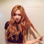 Rosé leaning against a wall