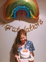 Jennie on her birthday holding her cake