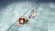 Eri watches Mirio collapsing for his injuries