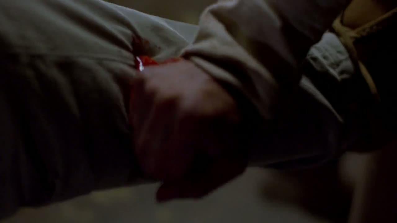 1x03 - Krazy 8 stabs Walt in the leg.jpg