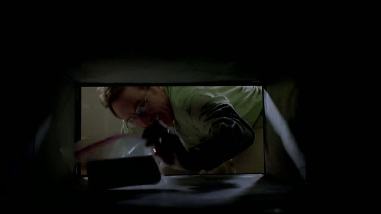 1x04 - Walt reaching for his hidden money.jpg