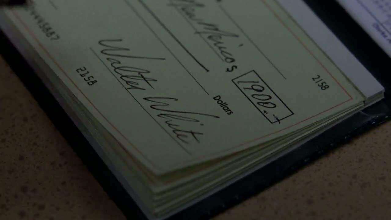 1x06 - Walt writes a cheque.jpg