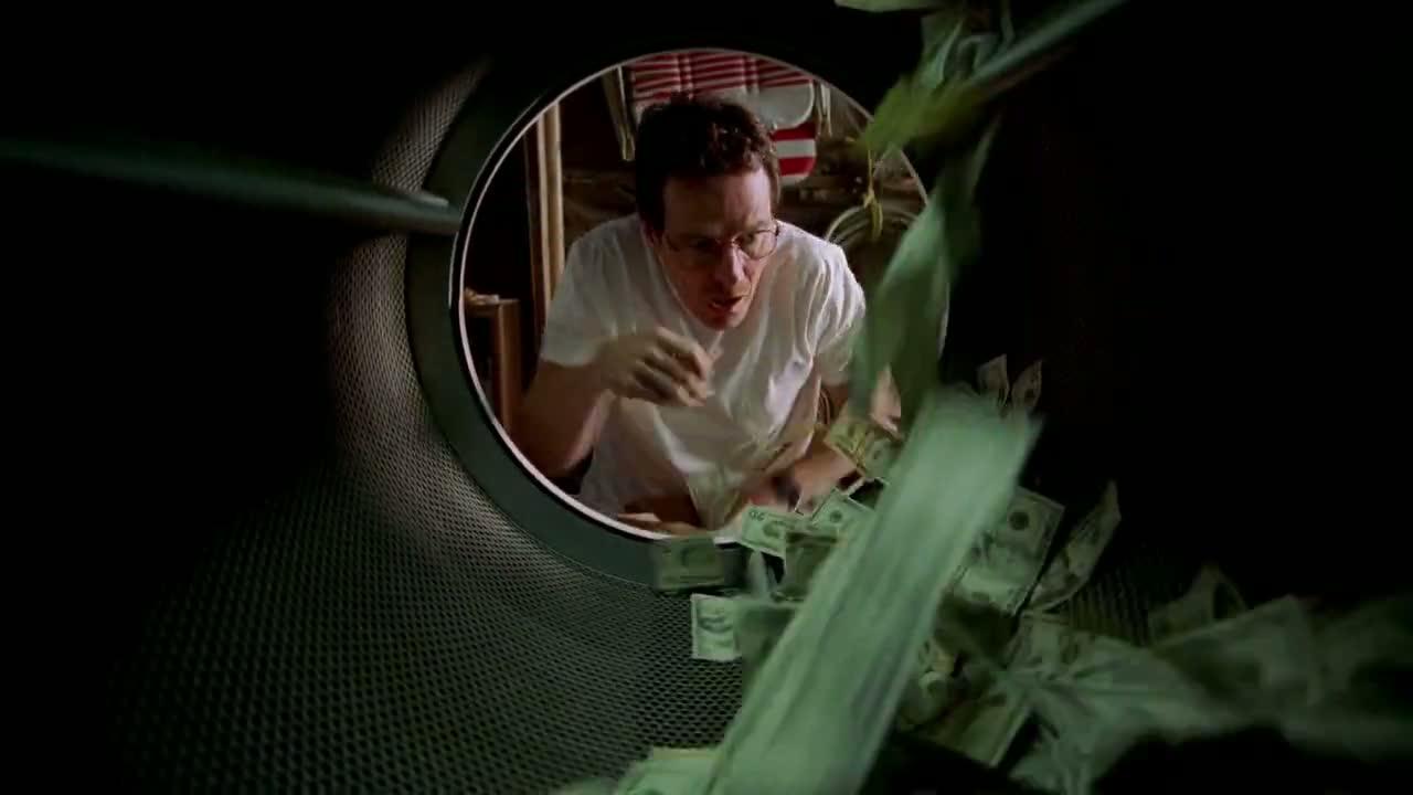 1x01 - Walt washing his money.jpg