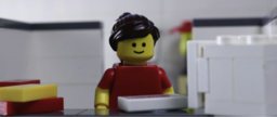 The woman stares at her computer