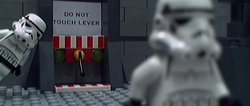The stormtrooper leaves after pulling the lever