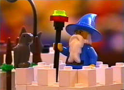 The wizard tells the LEGO figures to escape