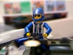 Legoman fires a turret