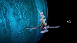 The memorial satellite drifts toward the Sentinel