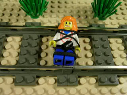 The woman is tied up before a moving train