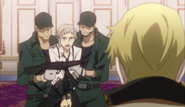 Atsushi being restrained by the guards