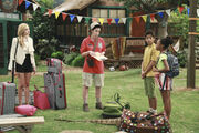 Pilot (Emma, Ravi, and Zuri arriving at camp with Gladys).jpg