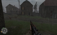 House to left of swastika house Approaching Hill 400 CoD2