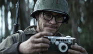 Drew holding his camera WWII