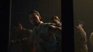 Takeo holds his hand on the prison bar for no reason BO4