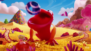 Candy frog consuming a striped candy
