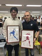 Takahashi with Andres Iniesta