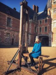 Lucy Worsley poses with the Guillotine that was used to behead her during filming of ''Royal History's Biggest Fibs: The French Revolution''.