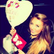 Chloë's got a balloon and a card
