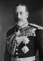 Pale-eyed grey-bearded man of slim build wearing a dress uniform and medals