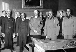 group portrait Edward Chamberlain, Édouard Daladier, Adolf Hitler, Mussolini, and Count Ciano, as they prepared to sign the Munich AgreementChamberlain, Daladier, Hitler, Mussolini, and Italian Foreign Minister Count Ciano, as they prepared to sign the Munich Agreement