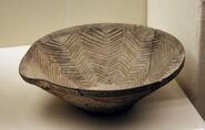 Mortar in the shape of a cup. Longshan Culture. Henan