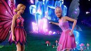 Barbie Mariposa & the Fairy Princess Rainbow Rocks skipping at GlowWater Falls