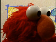 Elmo getting in front of the camera lens