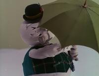 Sam unfolds his umbrella