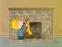 Sally hanging a stocking