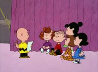 Charlie Brown giving instructions
