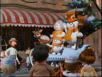 Frosty's family and Rudolph on parade