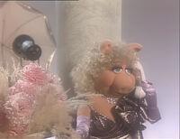 Piggy calling Kermit