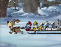 Smurfs riding a sled.jpg