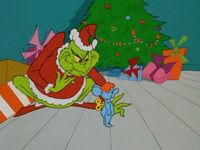 Grinch with wind-up toy
