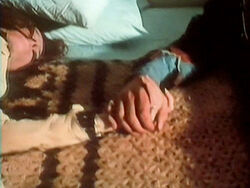 Medusa Luciana Paluzzi holding hands in death with George Hamilton.jpg