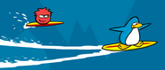 Red puffle playing susrf