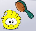 Yellow puffle being brushed
