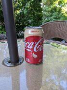 Vanilla Coke outside on a table