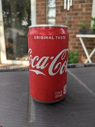 7.5oz Coca Cola on the stand next to my outdoor couch