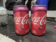 2 12oz Cans Of Cherry Coke