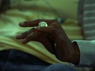 5x03-Abed rolls quarter across fingers