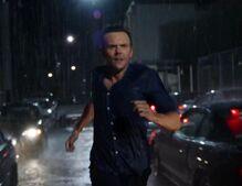 Jeff running in the rain.jpg
