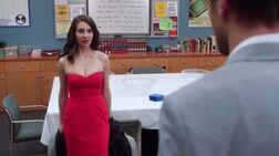 Evil Annie in a red dress.jpg