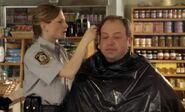 S04E01-Karen cuts Brents hair
