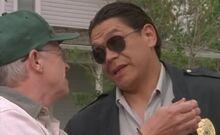 S01E07-Oscar w handcuffs Davis.jpg