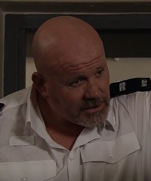 Prison Officer (Adam Fogerty)