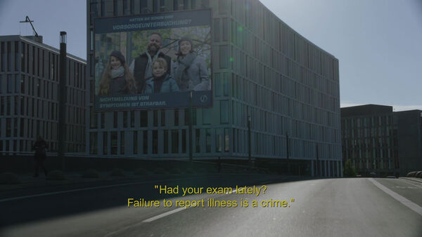 Dimension-Two-Billboard-Failure-to-report-illness-is-a-crime-Counterpart-Season-1-Episode-4-Both-Sides-Now.jpg