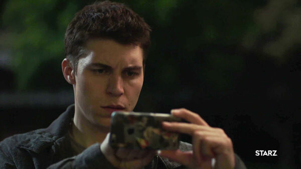 Nolan-Gerard-Funk-Oskar-Wolfe-figures-out-a-smart-phone-Counterpart-STARZ-Season-1-Episode-6-Act-Like-Youve-Been-Here-Before.jpg